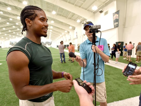 Michigan State defensive back Tyson Smith talks to