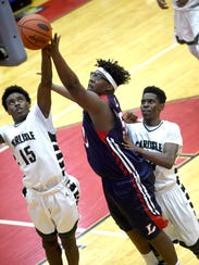 Lebanon's Khalique Washington goes up for a rebound