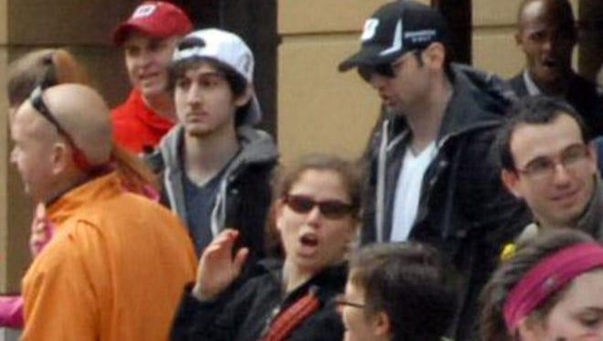 The Tsarnaev brothers in white and black caps in Boston in 2013.