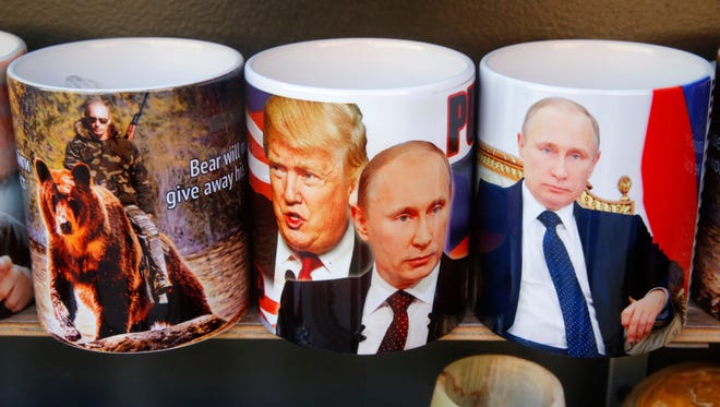 Cups depicting Russian President Vladimir Putin and President Trump are displayed in St. Petersburg, Russia, on Jan. 20.