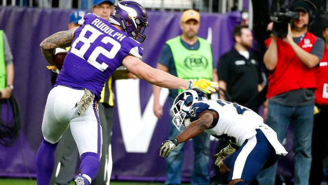 Minnesota Vikings tight end Kyle Rudolph (82) runs from Los Angeles Rams cornerback Blake Countess, right, after making a reception during the second half of an NFL football game in 2017 in Minneapolis.