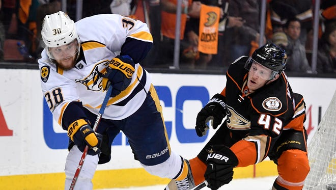 Nashville Predators left wing Viktor Arvidsson (38) plays the puck defended by Anaheim Ducks defenseman Josh Manson (42) during the third period of game 2 of the Western Conference finals at the Honda Center in Anaheim, Calif., Sunday, May 14, 2017.