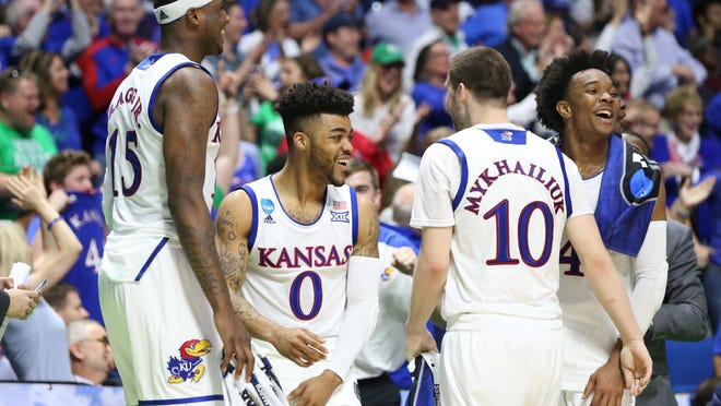 For MSU, hanging with Kansas begins with defending All-American point guard Frank Mason (0) an backcourt mate Devonte Graham (right).