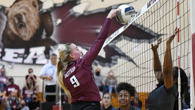 Bastrop's Layne Ellsworth gets the ball over the net against Pflugerville.