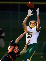 Edgar's Austin Borchardt leaps to catch a first-quarter touchdown pass over Stratford's Nick Stoflet on Friday to help the visitors win 15-13. Edgar, the top-ranked team in the Small Division of The Associated Press state poll, improved to 5-0.