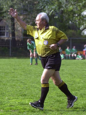Soccer referee Gino D'Ippolito referees a game between Irvington and Bronxville High School, Thursday, May 1, 2003 at Concordia College.