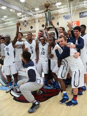 Sierra Canyon players accept the tournament trophy following their last second win over Pebblebrook on Tuesday, December 30, 2014 during the Open Division championship game of the MaxPreps Holiday Classic basketball tournament held at Rancho Mirage High School. Sierra Canyon won 67-66 scoring two points on foul shots with .8 seconds to play.