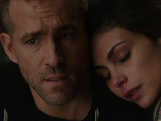 """Ryan Reynolds and Morena Baccarin in """"Deadpool."""" (Photo"""