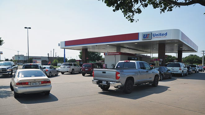As word spread of possible fuel shortages due to Hurricane Harvey, lines at local gas pumps lengthened considerably, like these at United Express Fuel on Fairway.