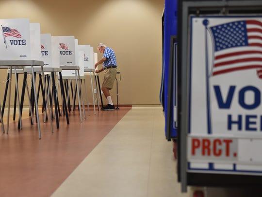 Poll preparation at the Havert L. Fenn Center on Nov. 7, 2016, in Fort Pierce.