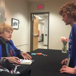 Riley Smith, 11, had Holocaust survivor Eva Moses Kor sign a book for him at Indiana University East on Tuesday night.