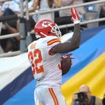 Spencer Ware celebrates one of his two TDs for the