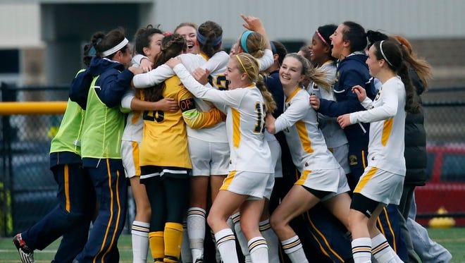 Spencerport celebrates their 2-0 win over Aquinas at Webster Schroeder High School.