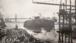 The USS Arizona is christened as a crowd watches on