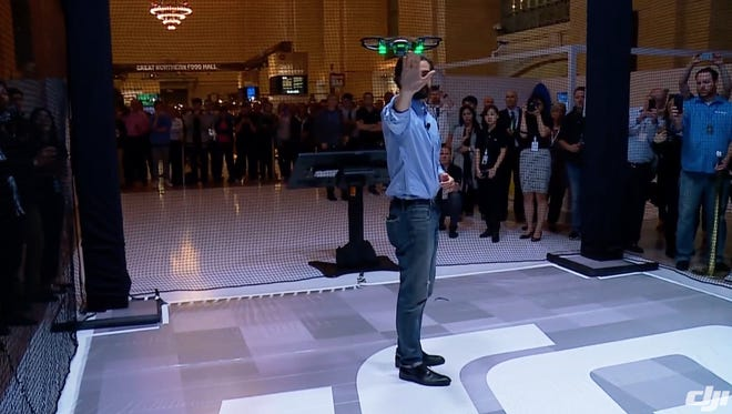 Michael Parry shows off hand gestures to fly the new Spark mini-drone