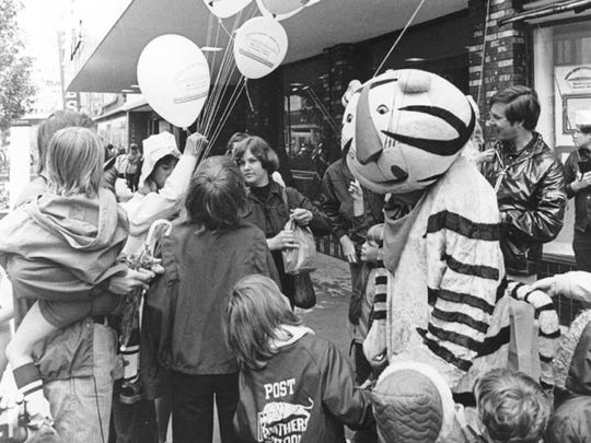 In this 1977 photo, Kelloggs Co. mascot Tony the Tiger greets children at the annual Cereal Festival.