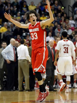 Ohio State guard Amedeo Della Valle cheers as he comes off the court for a timeout in the second half of an NCAA college basketball game against Nebraska in the quarterfinals of the Big Ten Conference tournament.