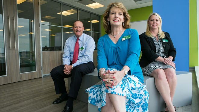 WSFS Chief Financial Officer Rodger Levenson (left), Chief Human Capital Officer Peggy Eddens (center), and Senior Vice President Retail Banking Shari Kruzinski inside the WSFS collaboration space in Wilmington.