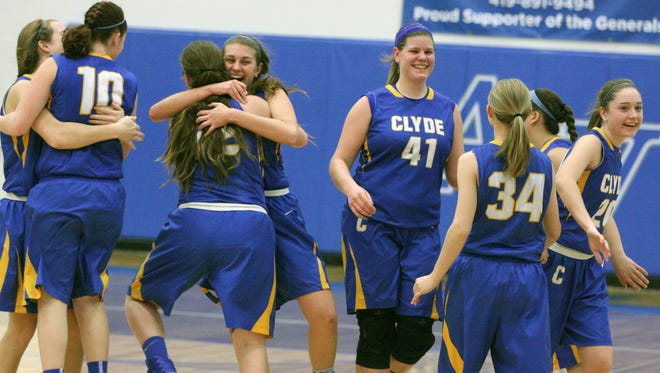 Clyde's Bree Dowling, center back, hugs a teammate celebrating a district championship Saturday.