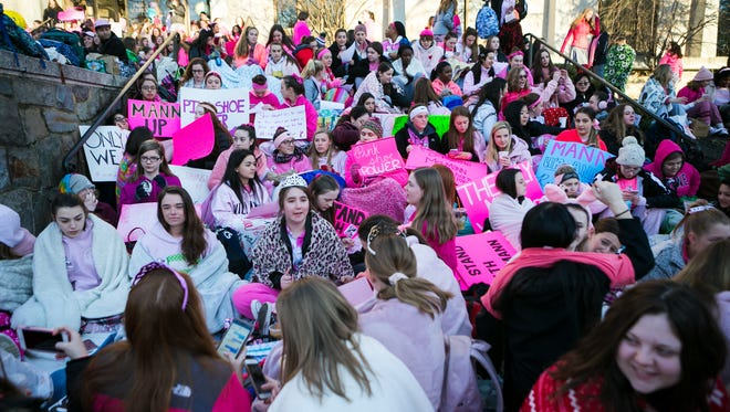 Students at Padua Academy gather outside the school wearing pink in support of Cindy Mann, the head of Padua Academy, who was abruptly fired Friday.