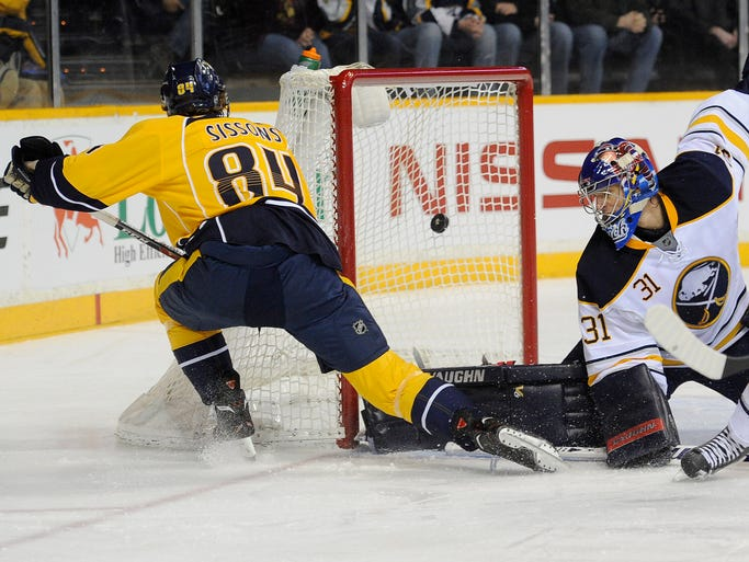 Nashville Predators center Colton Sissons (84) scores the first goal of the game and his first NHL goal by beating Buffalo Sabres goalie Matt Hackett (31) during the first period at Bridgestone Arena Thursday, March 27, 2014 in Nashville, TN.
