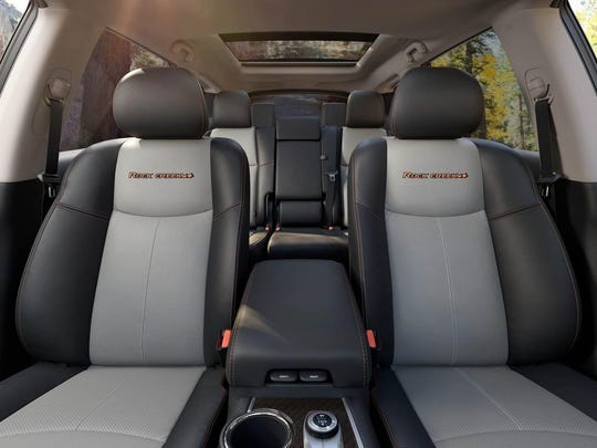 The two-tone seats offset the high-contrast stitching in the cabin.