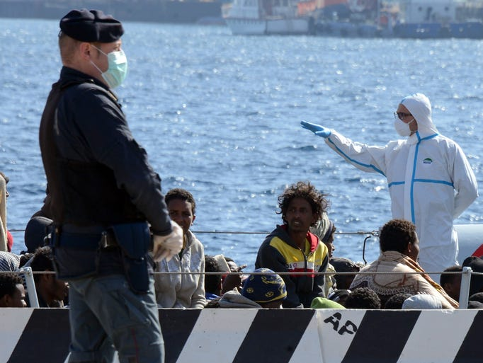 Migrants arrive in the port of Messina after a rescue