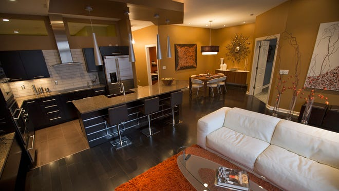 The main living area includes an open kitchen, dining room and living room with hardwood and tile flooring. The kitchen features granite countertops and stainless steel appliances.
