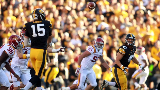 Iowa's John Kenny looks to make a catch in a game against Iowa State on Sept. 13, 2014.