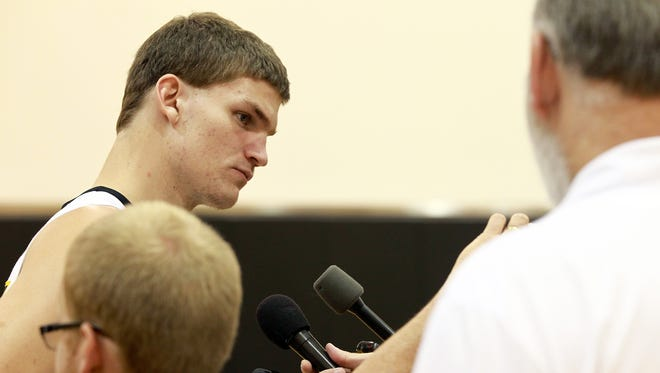 Iowa senior Adam Woodbury speaks to reporters during media day during media day at Carver-Hawkeye Arena on Wednesday, Oct. 7, 2015.