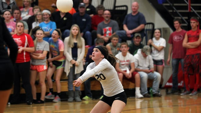 Lone Tree's Hailey Comer dives to the ball during the Lions' game against Highland in Lone Tree on Tuesday, Oct. 13, 2015.