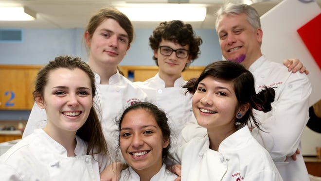 The state champion South Salem High School culinary team, front row from left, junior Karaline Richey, junior Lenis Camara Hernandez and senior Anna Donahe, back row from left, senior Draven Morehead, senior Sage Monaghan and instructor Todd Wieweck.