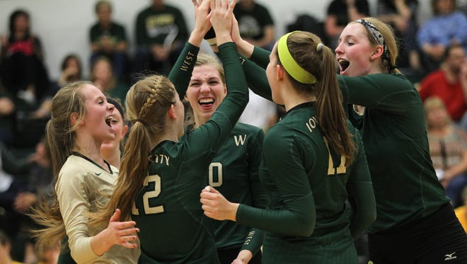 West High teammates celebrate a point during the Women of Troy's game against Waterloo East on Tuesday, Oct. 4, 2016.