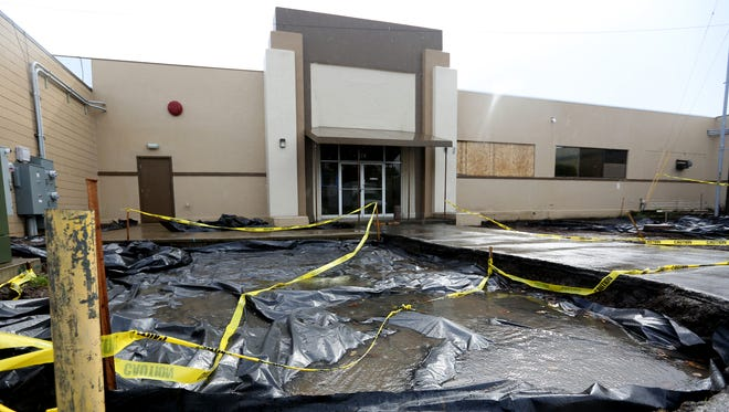 Soil was replaced outside a commercial building housing at least six businesses after extremely high levels of lead were detected in April 2017.