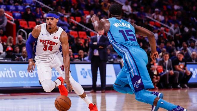 Pistons forward Tobias Harris dribbles past Hornets guard Kemba Walker during the second quarter at Little Caesars Arena in Detroit, Wednesday, Oct. 18, 2017.