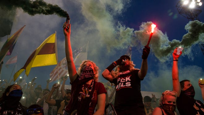 Fans lights up smoke at the 85th minute of a friendly game between Detroit City FC and Venezia FC (Italy) at Keyworth Stadium, Tuesday, July 18, 2017 in Hamtramck.