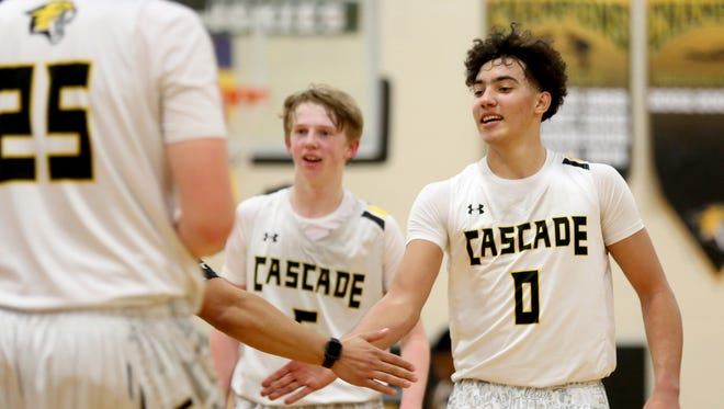 Cascade's Treyden Harris (0) high-fives teammates during a break in the second half of the Stayton vs. Cascade boys basketball game at Cascade High School in Turner on Friday, Feb. 9, 2018. Cascade won the game 52-44.