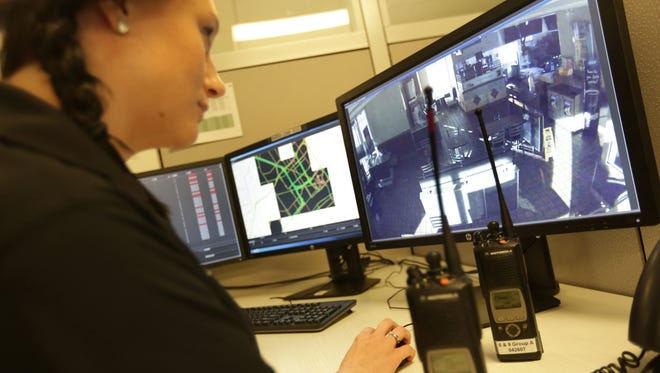 Crime analyst Breanna Lingo monitors video screens in the real time crime center at the Detroit Public Safety Headquarters in Detroit, MI on Monday, May 23, 2016.