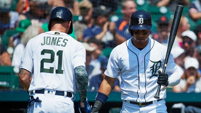 Tigers left fielder JaCoby Jones (21) receives congratulations from center fielder Leonys Martin (12) after scoring in the fifth inning on Sunday, May 27, 2018, at Comerica Park.