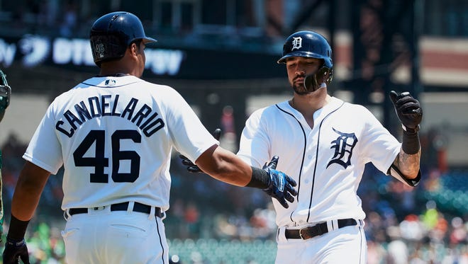 Nicholas Castellanos, right, receives congratulations from Jeimer Candelario after a two-run home run in the first inning on Thursday.