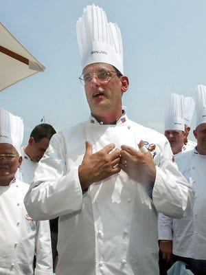 In this July 27, 2004 file photo, outgoing White House chef Walter Scheib greets chefs from around the world at the Chesapeake Bay Maritime Museum in St. Michaels, Md. Authorities are searching by air and ground in a rugged New Mexico mountain range for Scheib, reported missing on a solo hike.