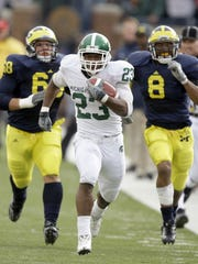 Michigan State's Javon Ringer races away from Michigan's Mike Martin and Jonas Mouton for a touchdown in the Spartans' 2008 win over the Wolverines - the game that began to flip the script on the MSU-Michigan rivalry in the Mark Dantonio era.