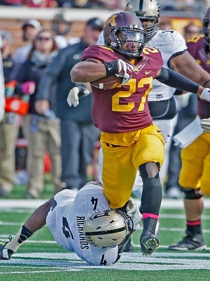 Gophers' running back David Cobb (27) can't be stopped by Purdue's safety Taylor Richards (4) in the first quarter as the Minnesota Gophers took on the Purdue Boilermakers, Saturday, Oct. 18, 2014 at TCF Bank Stadium in Minneapolis. Minnesota came out on top, 39-38. (Elizabeth Flores/Minneapolis Star Tribune/MCT)