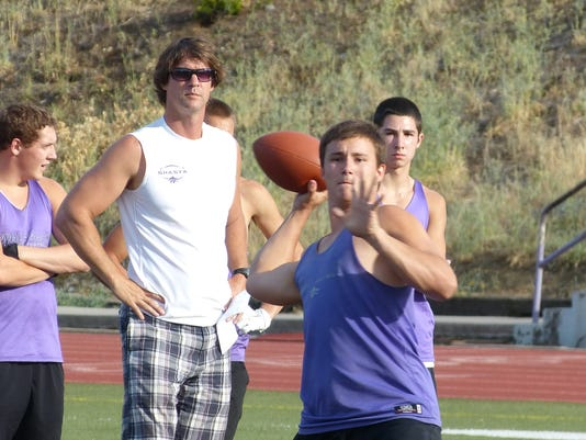 Colton Murrison winds up to throw a pass during passing league Thursday.