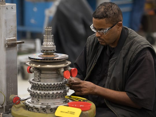 An employe works to refurbished an engine at Corpus Christi Army Depot on Wednesday, June 14, 2017.