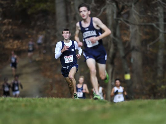 CBA's Brian Hill (#11) sprints to the finish line at the Cross Country Meet of Champions