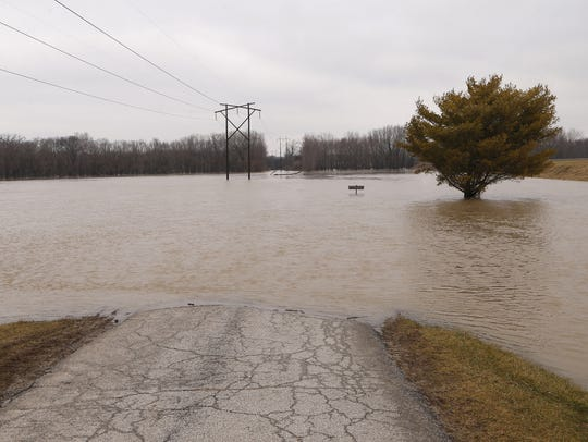 Flood waters cover Davis Ferry Park off North Ninth