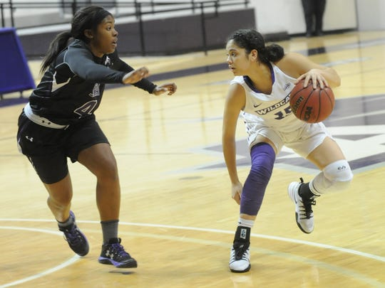 ACU's Alexis Mason, right, dribbles the ball while Stephen F. Austin's Kennedy Harris defends. SFA won the Southland Conference game 70-61 on Thursday, Jan. 12, 2017 at Moody Coliseum.