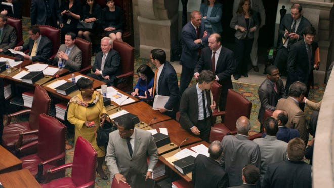 Senate Democrats, including Senate Democratic Conference Leader Andrea Stewart-Cousins, D-Yonkers, left in yellow, walk out of legislative session in the Senate Chamber at the Capitol on Wednesday, May 6, 2015, in Albany, N.Y. Democratic lawmakers walked out of the Senate in protest Wednesday after Republicans refused to allow the vote to remove Dean Skelos as Senate majority leader. (AP Photo/Mike Groll)