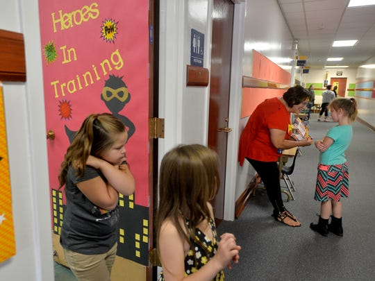 Corri Smith, principal at Whittier Elementary School, makes rounds dropping off birthday cards to students with August birthdays on Wednesday morning, the first day of school.